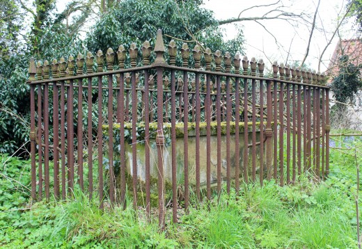 Tomb behind railings
