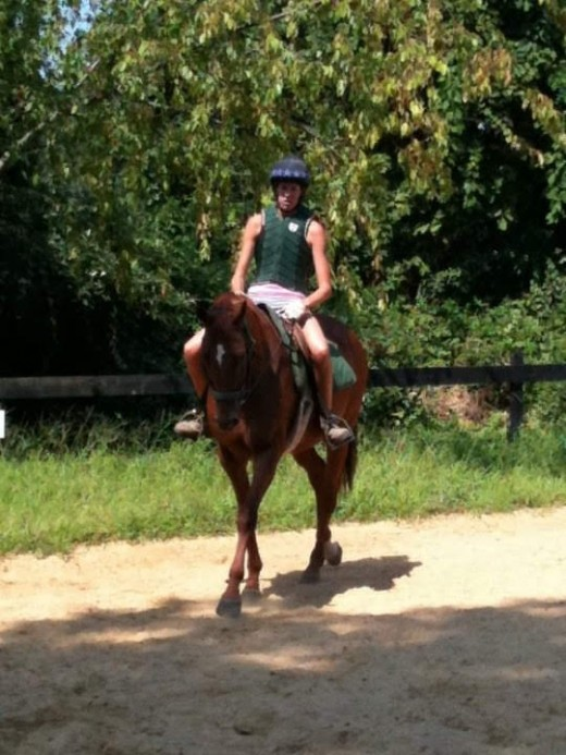 My crazy heart mare and I Zelda, don't mind my riding in shorts. At least I had on the important safety stuff, helmet, boots and body protector.