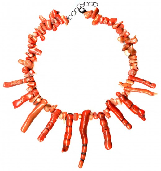 Orange coral assembled into a choker style necklace.