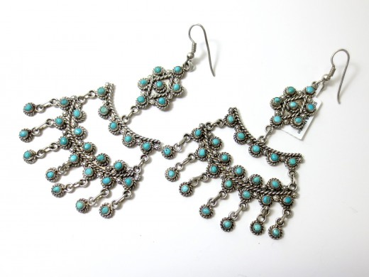 Turquoise beads mounted on silver earring foundations in an American Indian design.