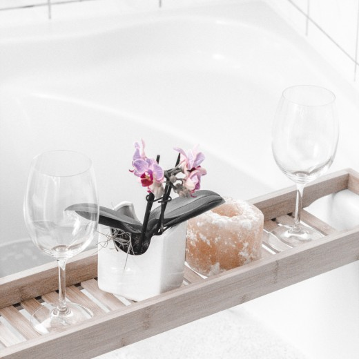 Surprising your girlfriend with a romantic bubble bath is a great idea to help her unwind after a long day at work.