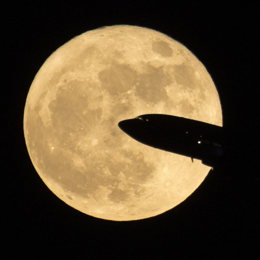 Moonrise in Washington D.C. and an aircraft taking off from Ronald Reagan National Airport, photographed Dec. 3, 2017. It was the first of three consecutive SuperMoons, as we have in 2019.
