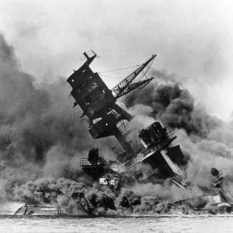 Sempill's perfidy did not only affect Britain - the famous shot of a vessel keeling over, enveloped in flames and smoke on Battleship Row at Pearl Harbor, 7th December 1941