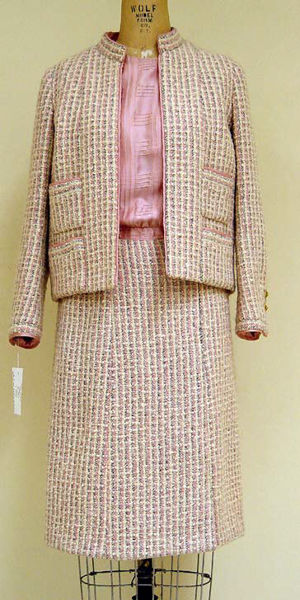Pink silk and wool suit, circa 1965. The suit was designed by Gabrielle Chanel.
