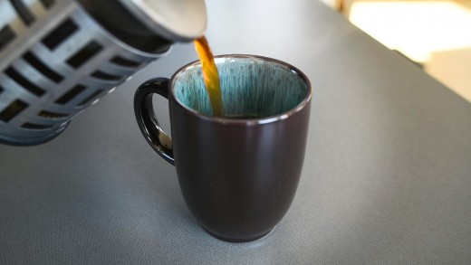Fresh cup of coffee from a French press.