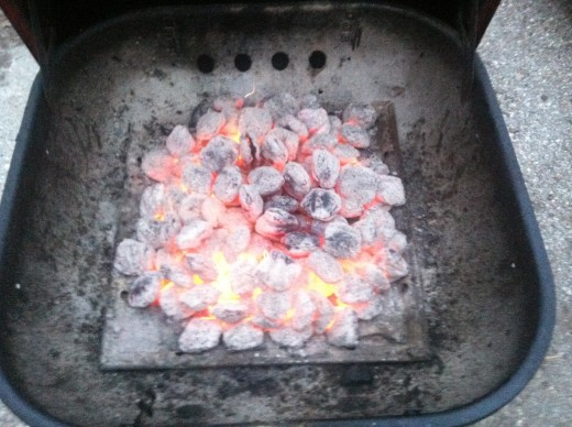 I have not yet added the grill grate, but this is how the coals should look prior to adding meat.