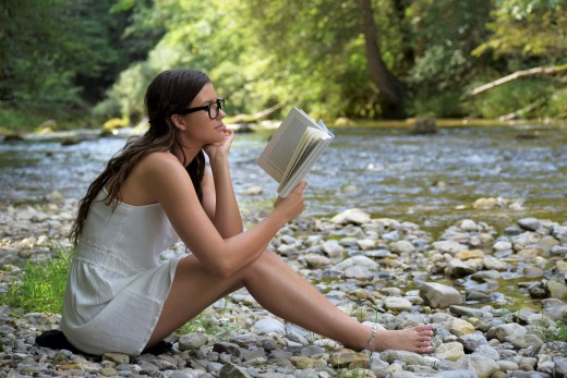 Taylor reading on the banks for the Pemi.