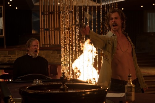 "Jeff Bridges and Chris Hemsworth as Father Daniel Flynn and Billy Lee in, ""Bad Times at the El Royale."""