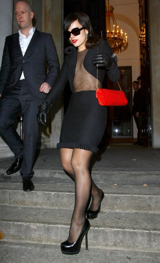 Lily Allen in a short pencil skirt and towering high heels