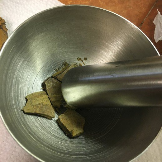 My stainless steel mortar and pestle with small chips of the rock in it.