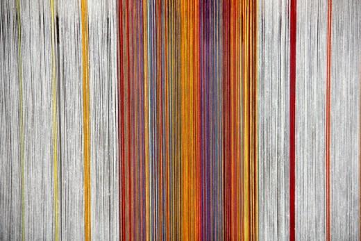 Threads on a loom.