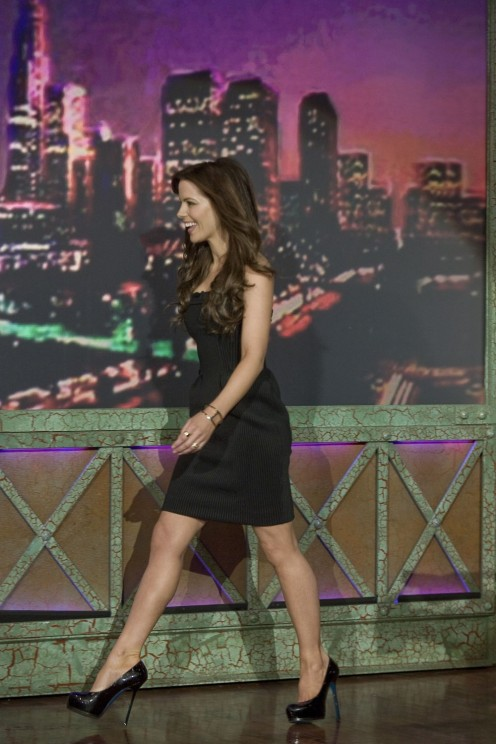 Kate Beckinsale in a little black dress and sky high heels