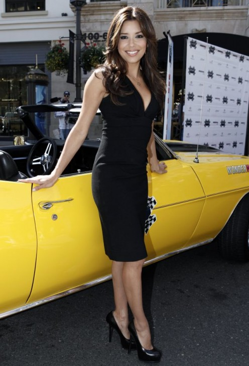 Eva Longoria Parker in a low-cut little black dress and towering high heel pumps