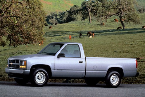 A light blue 1990 Chevy Pickup Truck