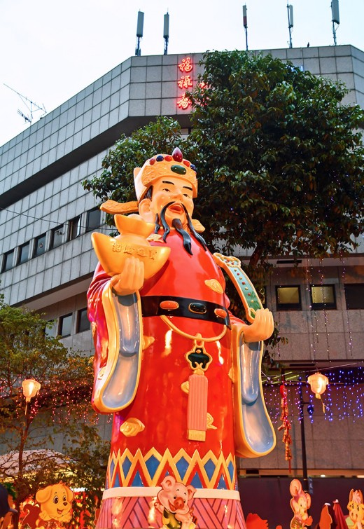 A huge Cai Shen, or Chinese God of Money, welcoming shoppers to the Waterloo Street festive market.
