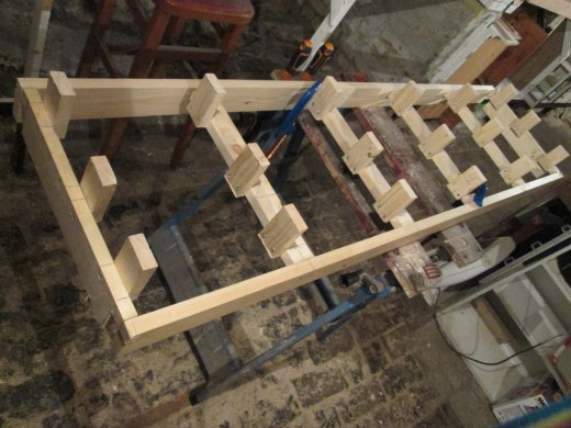 Framework assembled, risers screwed on, we're ready for the 6mm board to be set on top and fixed down