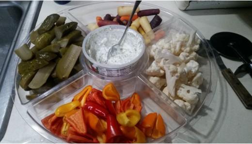 homemade pickles, fresh cut vegetables and a sour cream dip