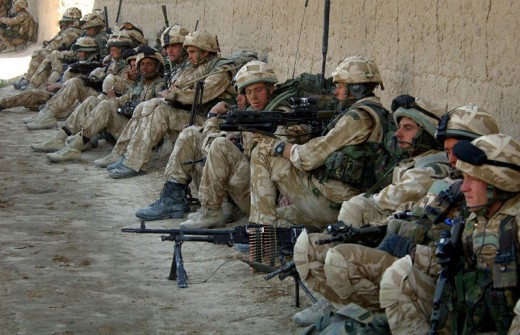 British troops saw service alongside US forces soon after in Afghanistan. No-one wins there against the Taliban, a lesson we should have learned when Lord Roberts' expedition came a cropper in the 19th Century - Royal Marine Commandos take shelter