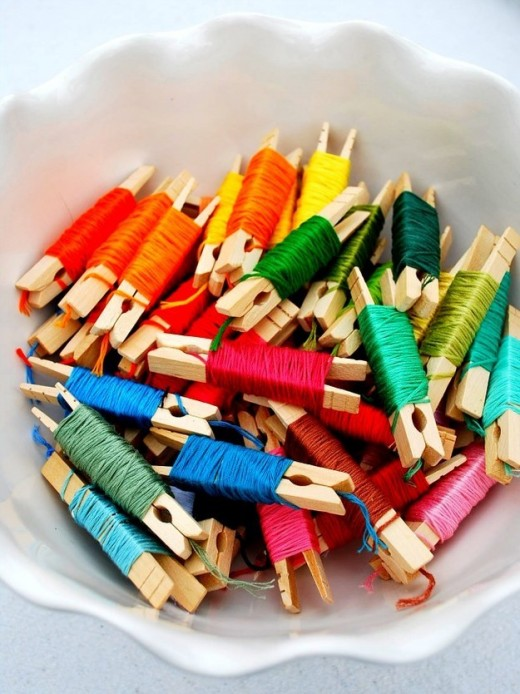 Wrap embroidery floss around clothes pins