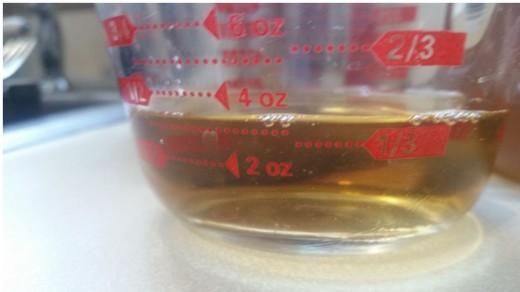 measuring vinegar. Final vinegar: 1 1/2 cups.