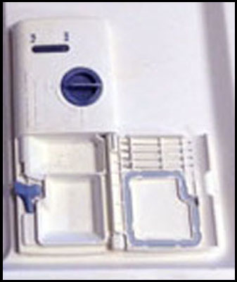 One example of a detergent cup holder.
