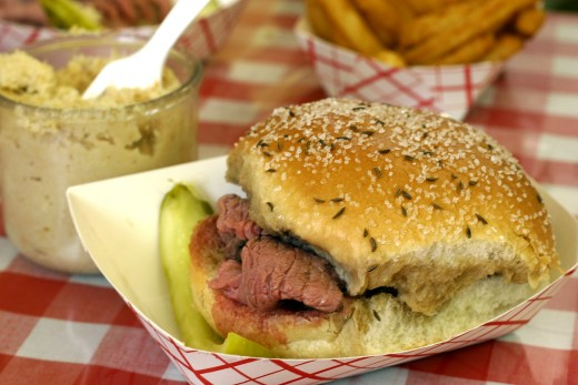 Tender, cooked-to-perfection, slices of roast beef on fresh, home-baked kummelweck rolls!   Mouth-watering delicious!
