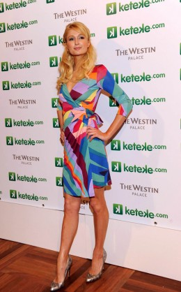 Paris Hilton is wearing a Diane von Furstenberg dress.  She paid $385