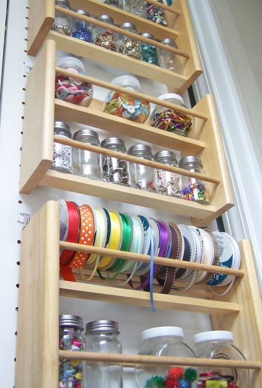 Use old spice racks to hold anything you have. As you use them, save spice jars for future organization. They can hold embellishments, ribbon and more.