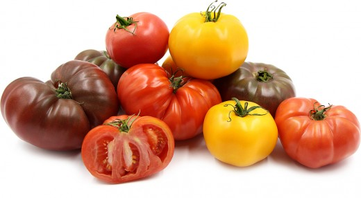 Heirloom tomatoes are a landrace varietal of tomato and the original before the creation hybrid tomatoes filled the current grocery market.