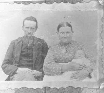 Abraham and Nancy Angeline Tower with their granddaughter, Helen Newton. If that identification of the infant is correct, the photo would be from 1897 (30 years after the war ended).