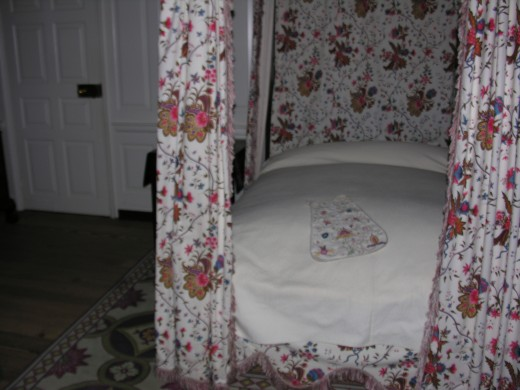 A bed inside the Governor's Palace.