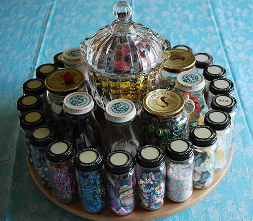 Another lasy susan uses spice jars and spagetti sauce jars. Very useful for embellishments.