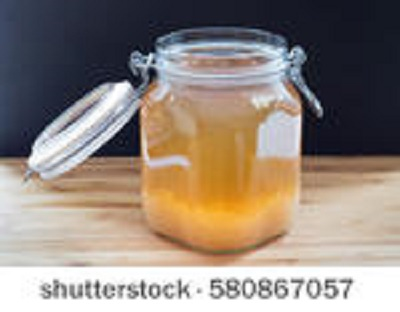 This is a picture of water kefir, or juice kefir, and grains.  The grains are in the bottom of the jar.