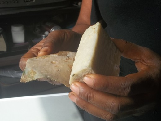 Wax being peel off cooked yam