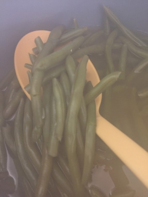 Steamy green beans will cloud your camera lens.