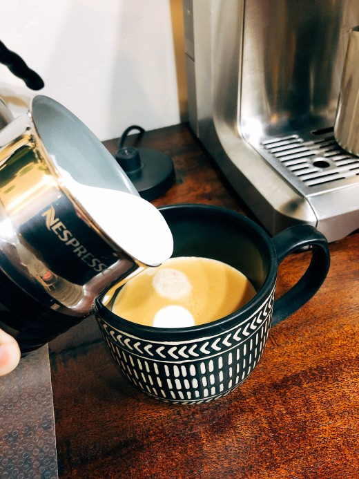 Pour the milk into the prepared cup of coffee that is brewed earlier.