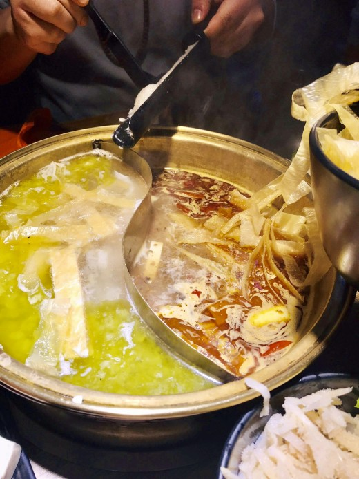This photo is showing one of the most popular dishes in China, which is the perfect symbol of socialization at a dinner: the hotpot, which is a sort of fondue in which you have to cook & eat the ingredients all together