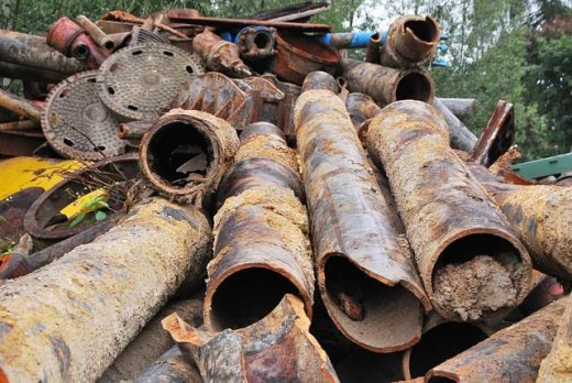 Construction waste scrap iron, like these old steel pipes, is infinitely recyclable.