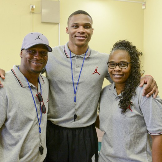 Russell Westbrook with his mum and dad.