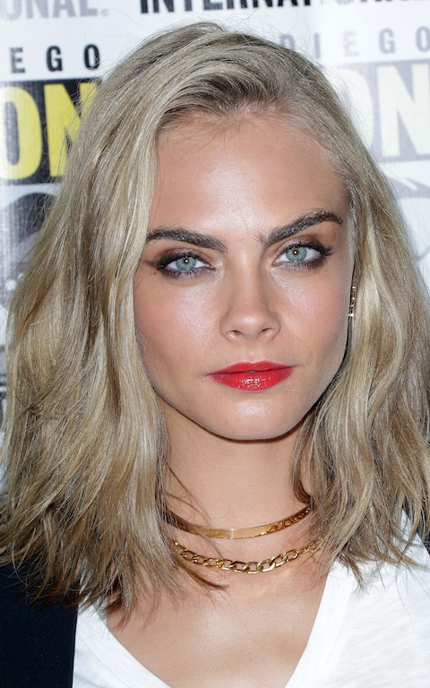 Cara's eyes are light blue, but iridescent. They are greeny, grey, bluey!