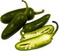 The Heat from a Jalapeno comes from the pith and seeds.