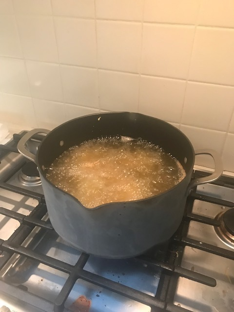 Stock pot with oil frying chicken