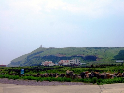 U-do Island, off the east coast of Jeju. At the top of Udobang Peak in the background are delightful sculptures and a lighthouse.