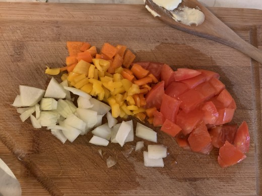 Chopped tomatoes, sweet peppers, and onion