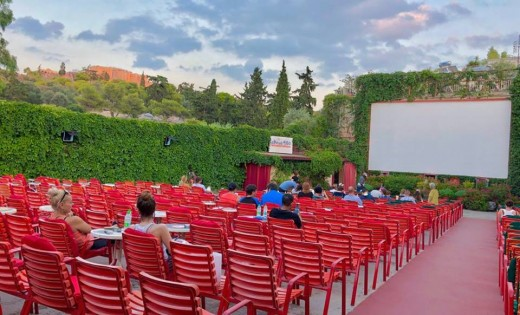 Watching a movie under the starry sky is a must include in every itinerary of Athens.