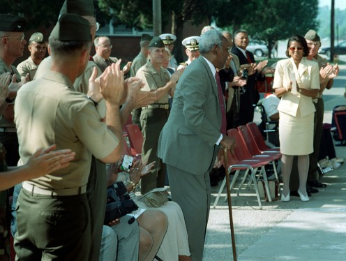Frederick Clinton Branch stands as the crowd applauds during the dedication of Branch Hall at the Officers Candidate School. at Quantico, Virginia; September 9, 1997.