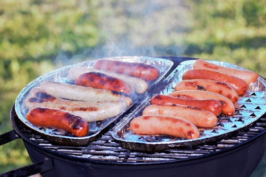 Sausage cooking on a grill