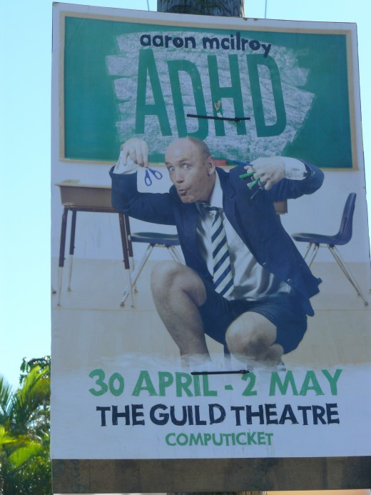 Among the election posters a well known SA Comedian advertises his show.