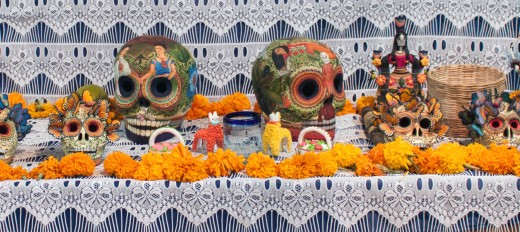 Ofrenda with folk art by renowned folk artists Josefina Aguilar and the Castillo family.