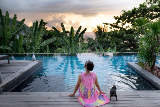 Woman and her dog on a tropical vacation